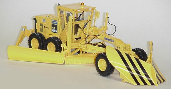 Komatsu GD 655 grader with V & wing CO. HWY. DEPT.