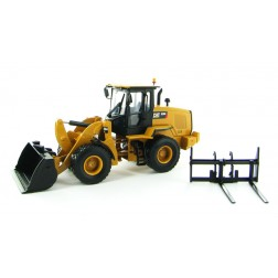 Caterpillar 930K wheel loader with bucket and forks