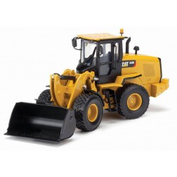 Caterpillar 938K wheel loader with bucket and forks