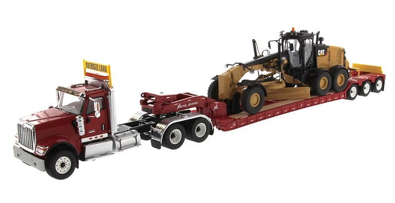International HX520 Tandem Day Cab Tractor with XL 120 Lowboy Trailer in Red and Cat 12M3 Motor Grader