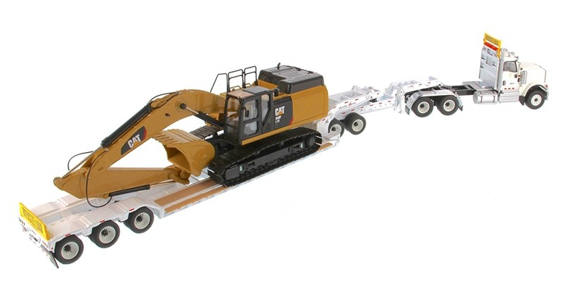 International HX520 Tandem Day Cab Tractor with XL 120 Lowboy Trailer and Cat 349F L XE Hydraulic Excavator