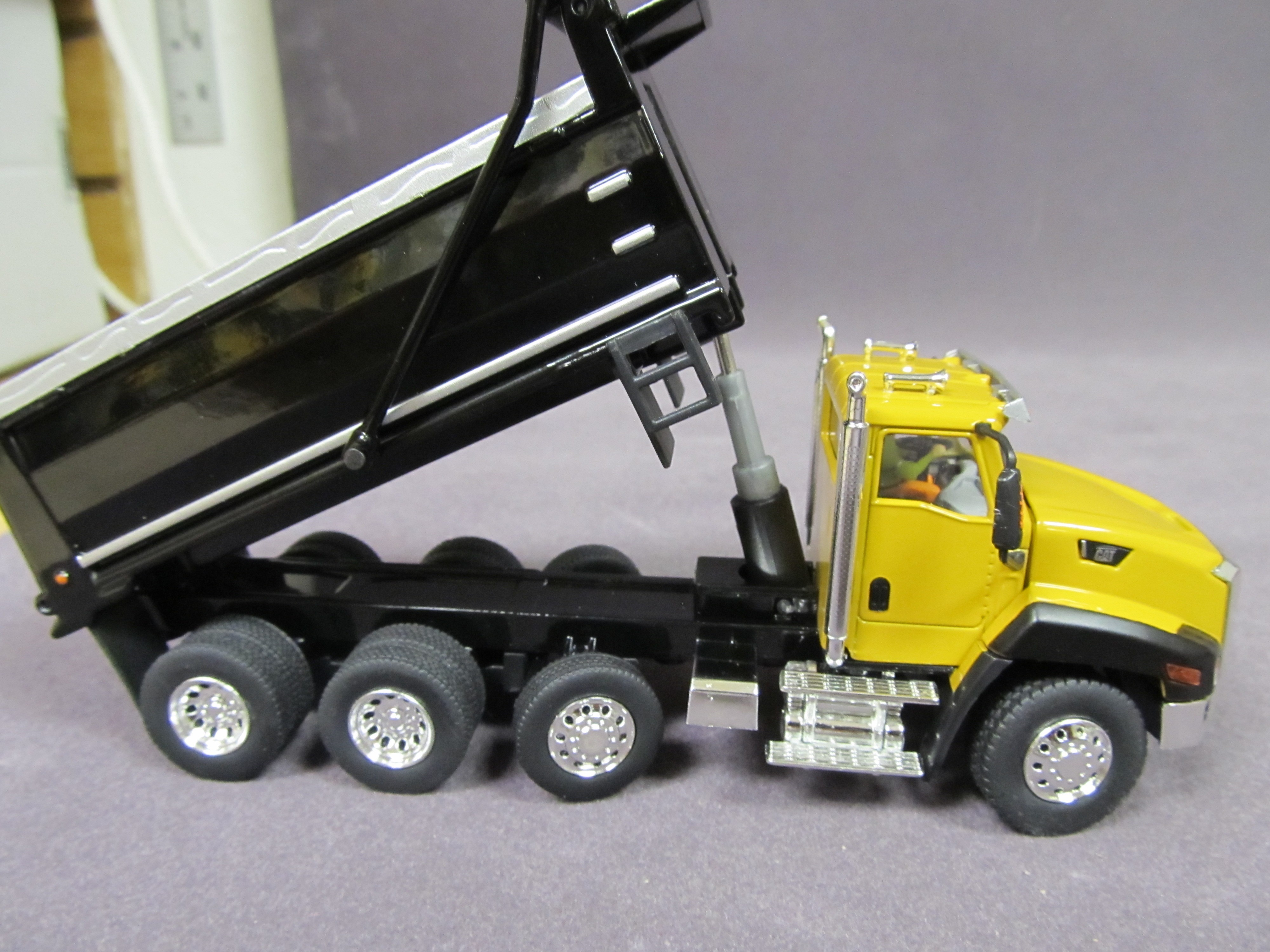 Caterpillar CT660 Yellow Dump Truck - DieCast Masters - Product Manufacturers